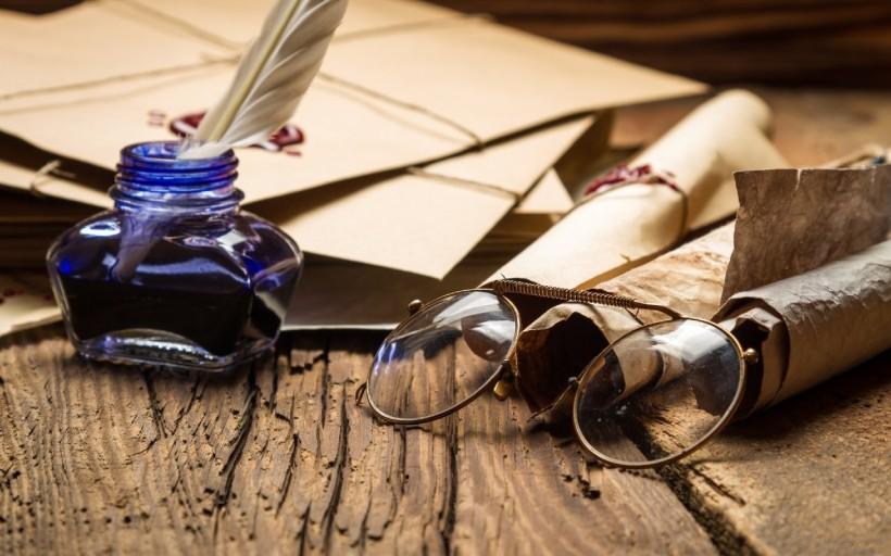 pluma y cartas